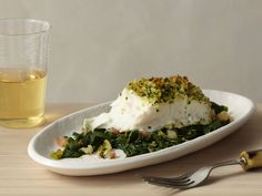 Panko-Crusted Swiss Chard : Halibut is a firm, lowfat, mild flavored white fish -- here, it's very simply prepared with a crunchy breadcrumb topping and served over a bed of sauteed Swiss chard.