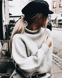Love the black belted look with this oversized gray sweater.