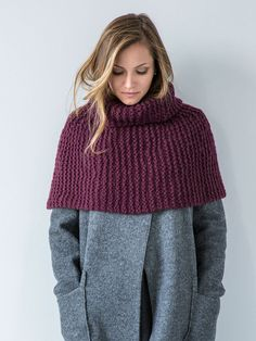 A cozy capelet is worked side-to-side in garter stitch. Short-row shaping helps hug the shoulders; cast-on and bind-off edges are grafted with Kitchener stitch in finishing. Capelet Knitting Pattern, Arm Knitting, Shawl Patterns, Crochet Patterns, Crochet Capas, Christmas Knitting Patterns, Wrap Pattern, Yarn Brands, Knitted Shawls