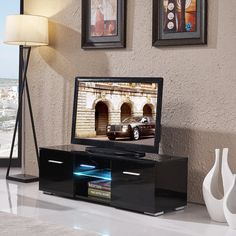 TV Stand Unit Cabinet w/LED Shelves 2 Drawers Console Furniture High Gloss Black. Assemble easily. Great design & premium quality. It comes complete with 2 doors & a glass shelf, aluminum handles. Product Size: 120cm(L)*40cm(D)*38cm(H) / 47''L*16''D*15''H. It has the capability to access the devices from the rear of the stand via the built in cable management area.
