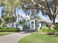 Big blue two story house with barrel tile roof - Barrington in Pelican Bay - Naples, FL