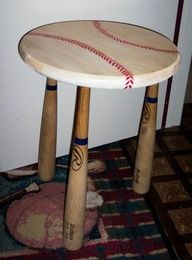 Table made out of baseball bats and round top painted like a baseball