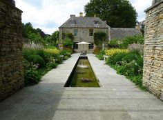The Canal Garden, part of the Dan Pearson-designed garden at The Old Rectory, Gloucestershire. .................. Image: Huw Morgan/Dan Pearson Studio