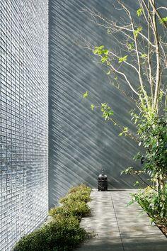 Optical Glass House, Hiroshima, Japan by Hiroshi Nakamura & Nap: just beautiful glass brick facade!