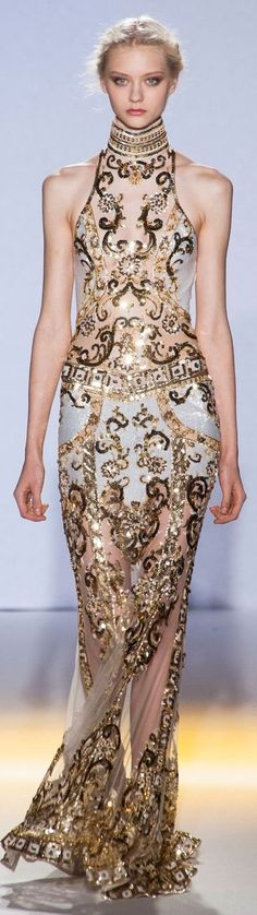 Gold embellished sheer in an hourglass silhouette.  I can see Nefertiti or Cleopatra dressed in this Zuhair Murad Couture gown as they walk to a gold-covered throne.