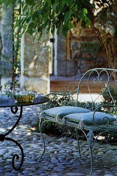 Garden seating for cozy dining & relaxing. The cobblestone street reminds me of the French Quarter in Charleston, SC.