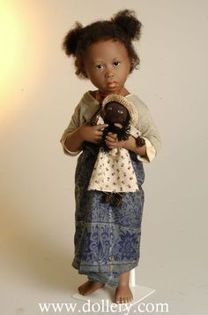 Malala. Mahefa and Malala are from Madagascar.  They both wear a Lamba oany.  This is a long tube of cloth worn around the waist or chest by folding around and tucked in. They combine the Lamba oany with a t-shirt instead of the traditional Kisaly.  Malala has a handmade ragdoll and Mahefa a bowl with little fish that she sells at the market.
