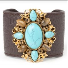 9/4 DEAL of the DAY! Was priced $49 Gorgeous cuff Leather surrounds a firm cuff. The turquoise stones are lab created. There are genuine tiger eye and Austrian crystal accents set in a gold tone alloy. This would be a great accent piece!!!! Comes nicely boxed perfect for gift giving!!!🌟👏🌟👏. ONLY 2 left!!!!         Please no additional discount on deal of the day!! Jewelry Bracelets