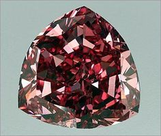 The World's Rarest Gemstone: Rare Precious Gems The Moussaieff Red Diamond. The largest red diamond (the rarest color of diamond) in history. In the rough, it is believed to have weighed carats. The diamond was purchased and cut by the William Goldber Gems And Minerals, Crystals Minerals, Crystals And Gemstones, Diamond Gemstone, Diamond Jewelry, Rare Gemstones, Rocks And Gems, Gems Jewelry, Jewellery Box