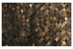 Stunning! The fish-scale-inspired pattern of this handmade rug comes from natural cowhide.