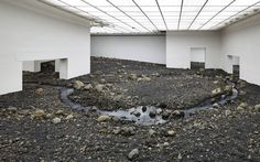 Olafur Eliasson, the artist best known for putting a giant sun in Tate Modern   in 2003, has transformed Denmark's Louisiana Museum of Modern Art into a   rocky riverbed