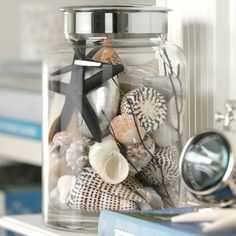 Good idea for any themed room...buy canisters or jars and fill them with items to accent the room. Tie a ribbon around as a finishing touch? Or leave lid off and drop a floral into the mix of stuff? Hmmmmm.....