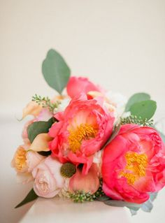 Soft pink roses and peach lilies combined with eucalyptus leaves make a gorgeous wedding bouquet