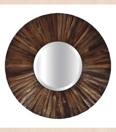 The circular Sun Ray mirror is made of redwood slats, allowing the woods texture to shine through.