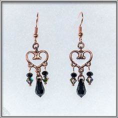 Elegant earrings featuring a copper heart with Swarovski drops