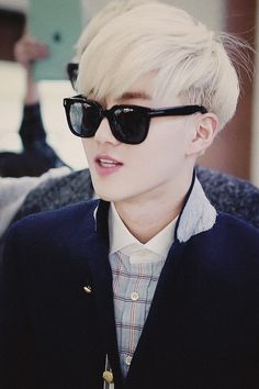 Suho with blonde hair....