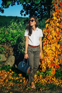 Shirt by Kate Spade, pants by Band of Outsiders, bag by Tory Burch, shoes by Dolce Vita. (September 10, 2014)