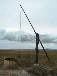 Picture of rural draw-well stock photo, images and stock photography. Wind Turbine, Wellness, Draw, Stock Photos, Pictures, Photography, Image, Photos, Photograph