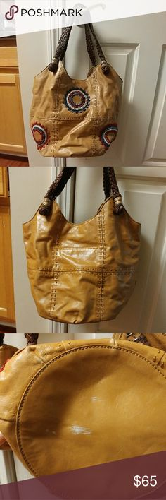 The Sak indigo tote Tan Tote from the Sak with super cute embroidery. Two small scratches on bottom, see pics, much more evident in photos than in person. Small spot on inside see 4 th picture. Barely noticeable with the design. Make me an offer!! The Sak Bags Totes
