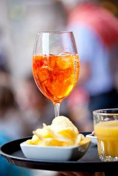 Summer drinks: aperol spritz - aperol, prosecco and sparkling water served with a slice of orange or a large olive.  Perfect Lake Garda sundowner
