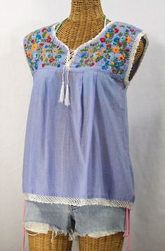 "Get a head start on Summer with the ""Marbrisa"" Embroidered Sleeveless Peasant Blouse Top in Periwinkle by Siren, $48.95."