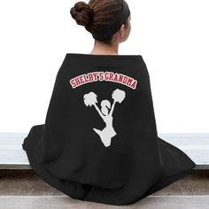 Proud Grandma Blanket | Keep warm in the stands while supporting your favorite cheerleader! Can be customized for any sport and any name. Choose your team's colors too!