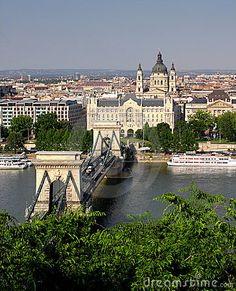 View of the chain bridge, with the church behind, in Budapest, Hungary - Kate's home in THE GOOD MASTER by Kate Seredy. For fun, multisensory ways to connect kids to this story, get instant access to the LitWits Kit at https://litwits.com/the-good-master/