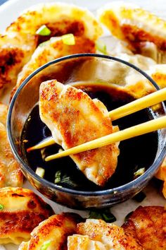two chopsticks holding a potsticker getting ready to dunk it in potsticker dipping sauce on a tray with many potstickers Sauce Recipes, Pork Recipes, Asian Recipes, Cooking Recipes, Ethnic Recipes, Potsticker Dipping Sauce, Crab Cake Sauce, Fried Rice With Egg, Appetizers