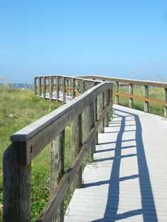 One of my favorite views in the world....the bridge across the sand dunes  from Jimmy B's leading to my most favorite beach....St. Pete!