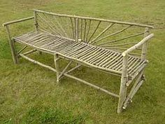 Yep, I'm gonna do this. Garden bench made out of branches, and I have a ton in my back yard.