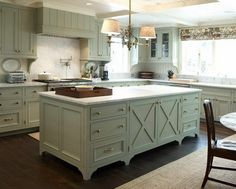 This kitchen island base is perfection. Different counter top with a little more hangover and not the same color cabinets in the surrounding area.