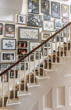 Framed posters and publicity shots line the staircase wall showcasing the many roles Catherine's husband has played