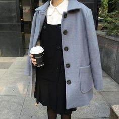 Pale blue peacoat with collared button up and black dress