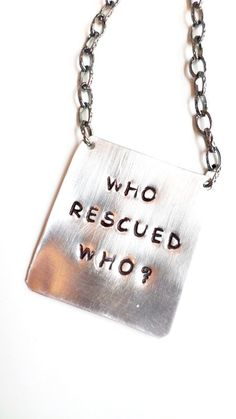 who rescued who unisex handstamped metal pendant by ShanBDesigns