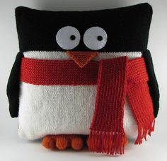 A knitted penguin cushion, but think that he'd look just as cute made from polar fleece