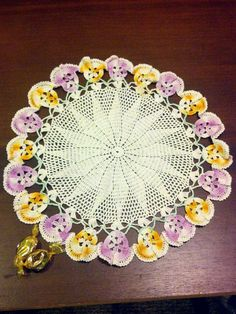 Crocheted Pansy Doily in Purple and Yellow by BlindedByDelight