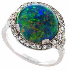 Art Deco black opal and diamond ring by J. E. Caldwell, circa 1925.