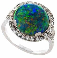 Art Deco black opal and diamond ring by J. E. Caldwell, circa 1925.