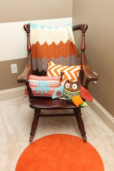 orange and turquoise baby nursery rocking chair. Love the color palette