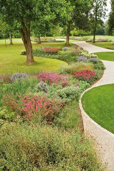 Curving planting beds frame lawn areas beautifully.  Piet Oudolf ~ Gräflicher Park, Bad Driburg in North Rhine-Westphalia, Germany.