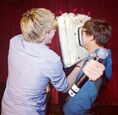 Why is Niall face planting Louis in a cake? Oh well, it's funny so who cares!?