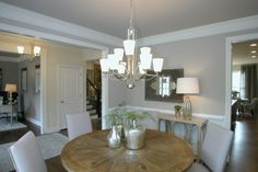 Dinin room at Sterling on the Lake - Tipton Homebuilders Flowery Branch, North Atlanta, Building A House, New Homes, Floor Plans, Chandelier, Ceiling Lights, Interior, Georgia