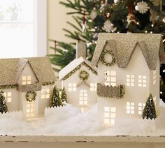 White houses with silver glass glittered roofs and balconies ~ oh I love that!
