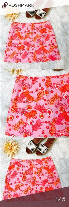 """Lilly Pulitzer Tango Tigers Skirt Lilly Pulitzer Tiger Mini A-Line Skirt. Pink Print of Adorable Tigers and Pretty Flowers. Additional For Your Lilly Collection. Laid flat across @ waist: 14.5"""", length: 15.5"""". NWOT Lilly Pulitzer Skirts Mini"""