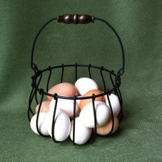 """Wrought iron egg basket -- made in USA.   Link goes to """"5 Favorite Egg Baskets"""" post."""