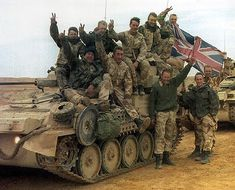 British soldiers posing for a photo in Saudi Arabia during the gulf war.