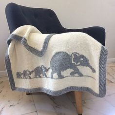 Ravelry: Elephant Family Blanket pattern by Mathilde RThis blanket is the ideal gift for baby! Its size is perfect to wrap baby up from birth to his first years. Languages : French & English Material : - Needles - Wool used for this model: 8 skeins of Dro Elephant Baby Blanket, Elephant Family, Baby Knitting Patterns, Baby Patterns, Blanket Patterns, Intarsia Knitting, Elephant Pattern, Knitted Baby Blankets, Crochet Baby