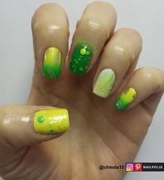"Thumb with yellow base & green stud. Middle with green base & yellow stud. Both topped with matte & shimmer sparkle topcoat. Pointer & pinky with yellow to green gradient with chrome silver stamped feathers. Ring with white base topped with feather. Look inspired by my budgie Chuchi and his feathers that he sheds. Products: Ruby Kisses HDP18 ""Whiter than White"", HDP07 ""Happily Yellow"", RNPN32 ""Clover Field"", HDPNG02 ""Greenlight?"", Joe Fresh ""Tin"", Bundle Monster plate BM-605 January 2017"