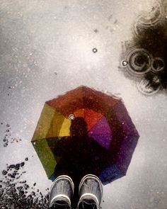A splash of color on a rainy day<br/>  <br/>  <br/>  rain, puddle, rainbow, umbrella...