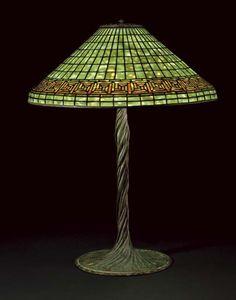 TIFFANY STUDIOS A 'GREEK KEY' LEADED GLASS AND BRONZE TABLE LAMP, CIRCA 1910 | Christie's